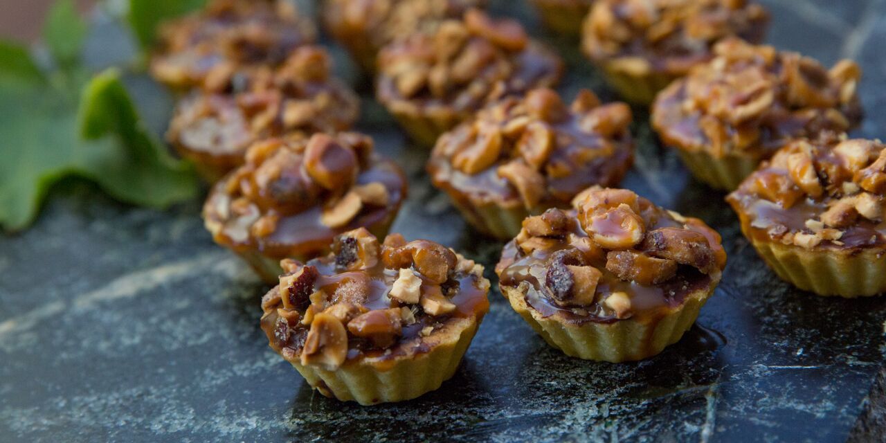 Appetizer tarts with nuts on top