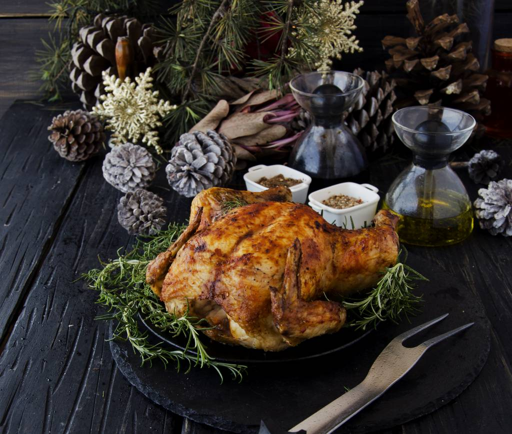 Roast turkey on a table with rustic decor