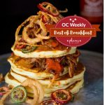 OC Weekly Best Of Breakfast Lumberjack Pancakes with Fresno Chilies, Pulled Pork, Fried Onions & Bourbon Maple Syrup
