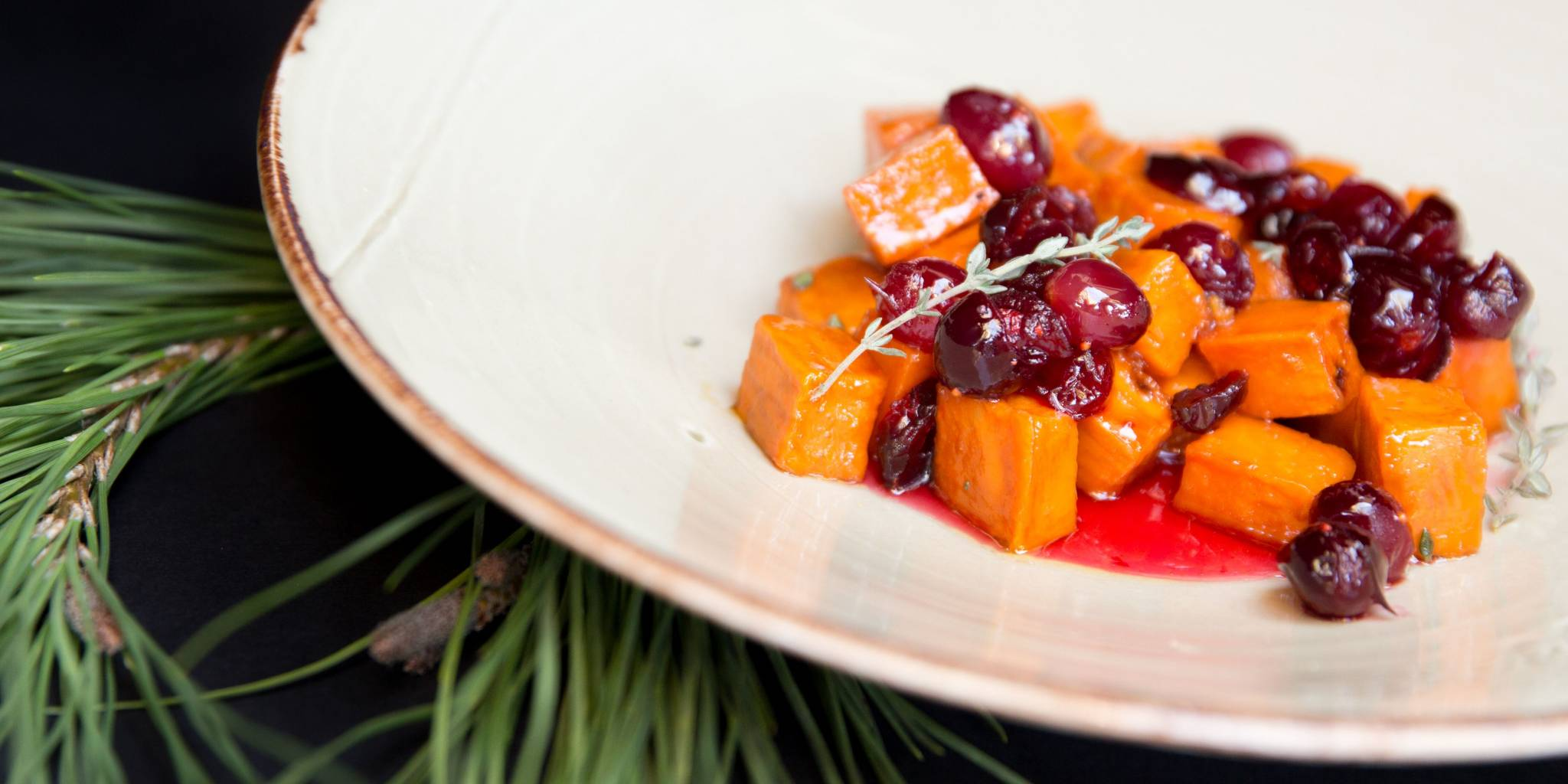 Squash and cranberries with a sprig of rosemary