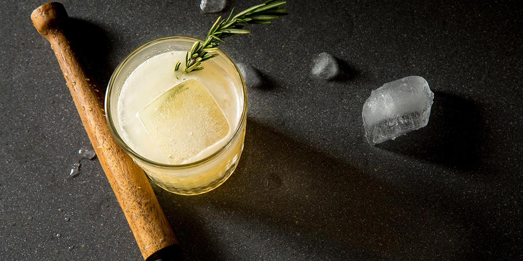 Artisan cocktail with a sprig of rosemary